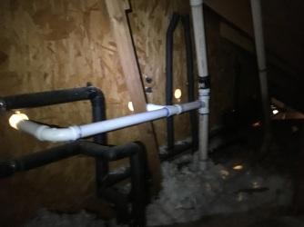 The crawlspace drain plumbing view