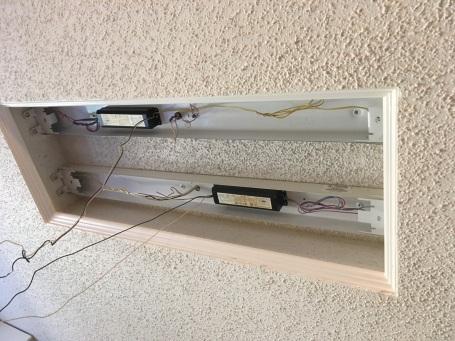 An inside view of flurescent wiring