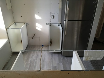 """Test fitting the hanging """"base"""" cabinets"""