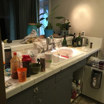 Chipped tile countertops and breakfast bar